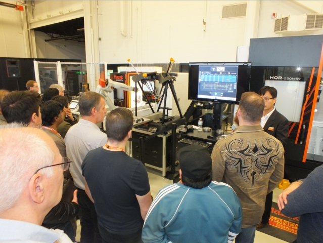 Attendees listen to Renishaw's David Chang as he explains the benefits of the new Equator 500