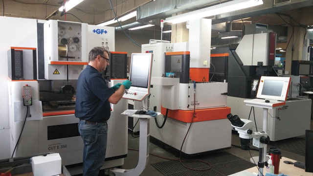 Measuring a part off the GFMS EDM Wire-Cut E350. in B&R Custom Machining's Cambridge, ON, machine shop.