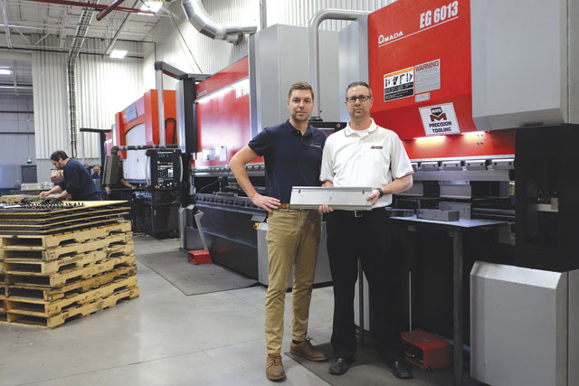 Brian Heins, IMP's general manager, left, with Peter Visser of Mate Tooling. IMP improved fabricating efficiencies as a result of an investment in new Amada equipment and new Mate press brake tooling.