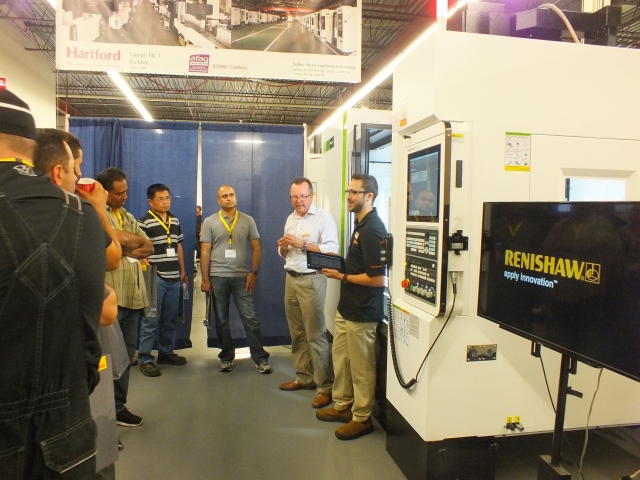 Attendees listen to Renishaw's Jayden Rodgers and Philip Smith explaining the company's Set & Inspect probing app on a Hartford machine Hartrol Smart CNC control