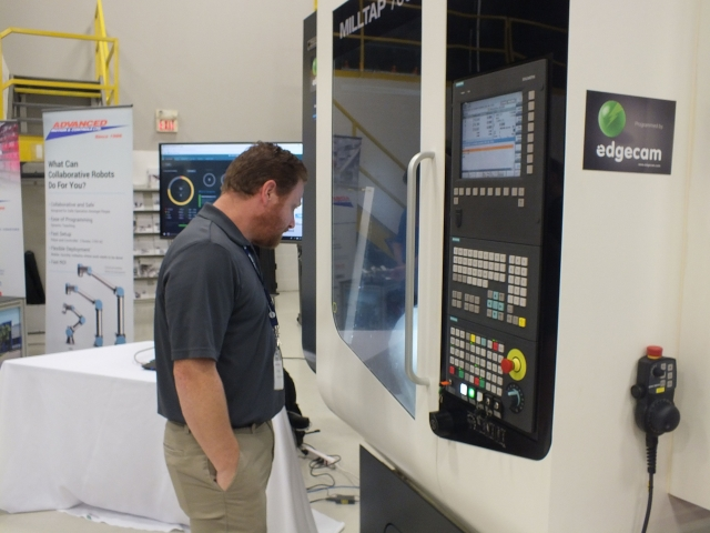 Bill Byers, CNC technical speciality with PCC Centra Industries checks out the Milltap 700 DMG MORI machine.
