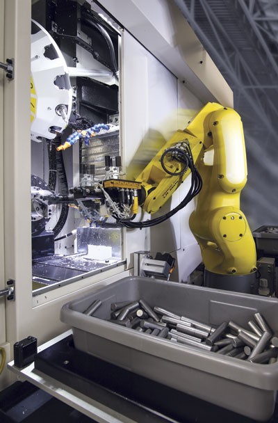 Vision-equipped robots are clever enough to pick raw material blanks out of a box, orient them properly, and keep the machine running, just like a human would.  Image: FANUC