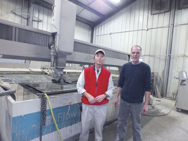 Fred Jones, left, with Derek Loebsack. The two have worked together in the waterjet industry for 18 years.