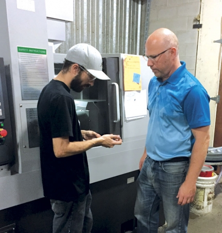Machinist Jordan Court, left, with Adam Zurbrigg. The company has seen significant growth in automation projects with some projects valued at more than $1 million.