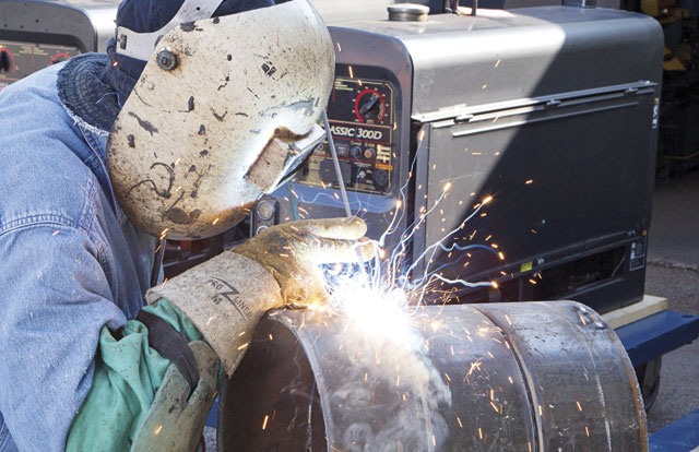 Stick welding excels in outdoor repair and maintenance work.  Image: Miller Electric