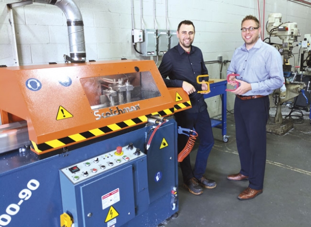 Paul Terpstra and Bart Huizinga with the fire fighting tool cut on the Scotchman saw.