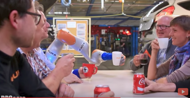 "Ford's new ""employee"" on the automotive assembly line, a KUKA robot arm"