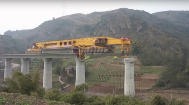 Extreme machines building extreme bridges
