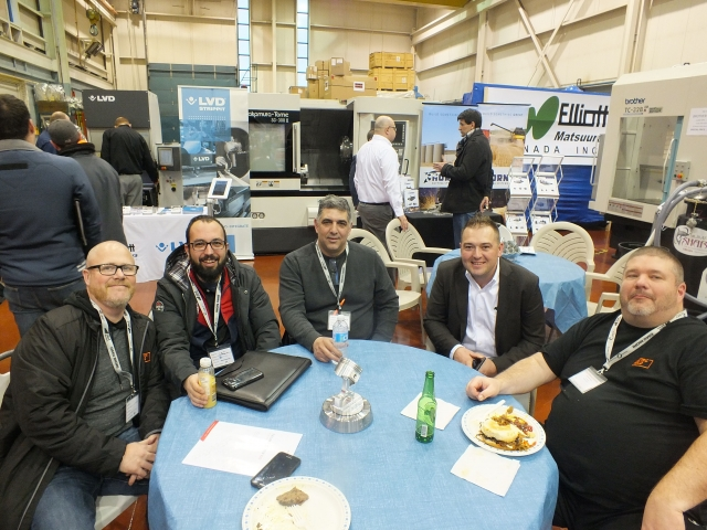 Relaxing at Elliott Matsuura's open house from left: Kevin Hulme, Metric Mold; Jack Chimienti, Advanced EDM; Andy Lombardi, Rova Machine; Joe Poulin, Elliott Matuusra; and Tim Alewick, Metric Mold.