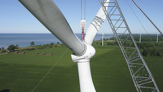 Turbine blades and rotor being hoisted into place. Image: John Kirby, Erie Shores Windfarm, Ontario