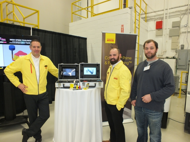 Chad Robillard of Nutech Precision Metals, far right, with Sandvik Coromant's Brian MacNeil, far left and Todd Macdonald, middle