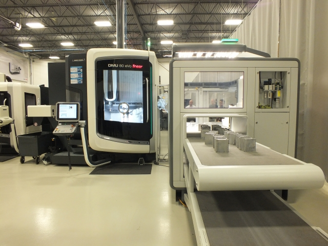 Part of the machining demonstrations included this automated handling solution, the ABB FlexLoader on a DMG MORI DMU 80 eVo linear machine