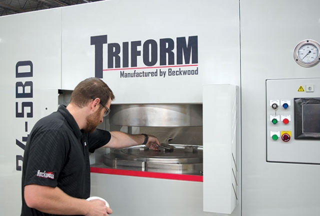 Using a 610 mm (24 in.) diameter Triform sheet hydroforming press, this operator formed three different parts in a single cycle.