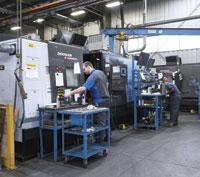Forty Doosan CNC machine tools fill the production floor at Hydra Dyne Technology.