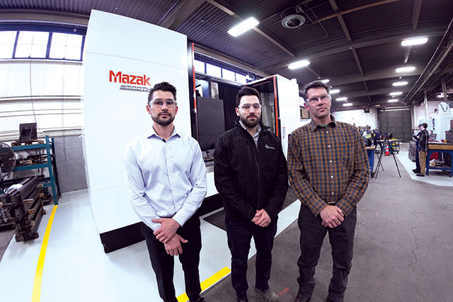 From left: Robert, James and Michael Pinelli with the Mazak VTC-805G machine.