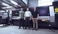 From left: Jody Seufert, one of Reggin's machine operators, Phil Alle, company president, and Brett Kostka, head of design who also runs the company's CNC programming.