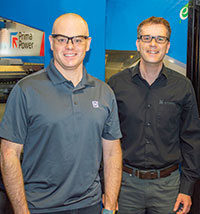 "Pierre Gagnon, methods and process technician, left, and Kevin Baker, technical manager, say their experience with Prima Power equipment has been ""very positive."""