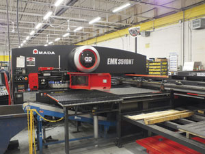 Bayview Metals uses Wilson Tool punch toolng on all three of its Amada machines, including this customized tooling on the right that increased punching productivity.