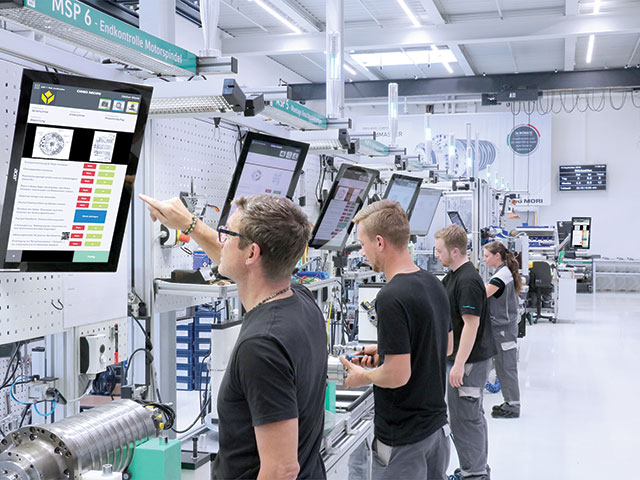Technicians assembling spindles at DMG MORI rely on the company's TULIP software for information and work instructions.  DMG MORI