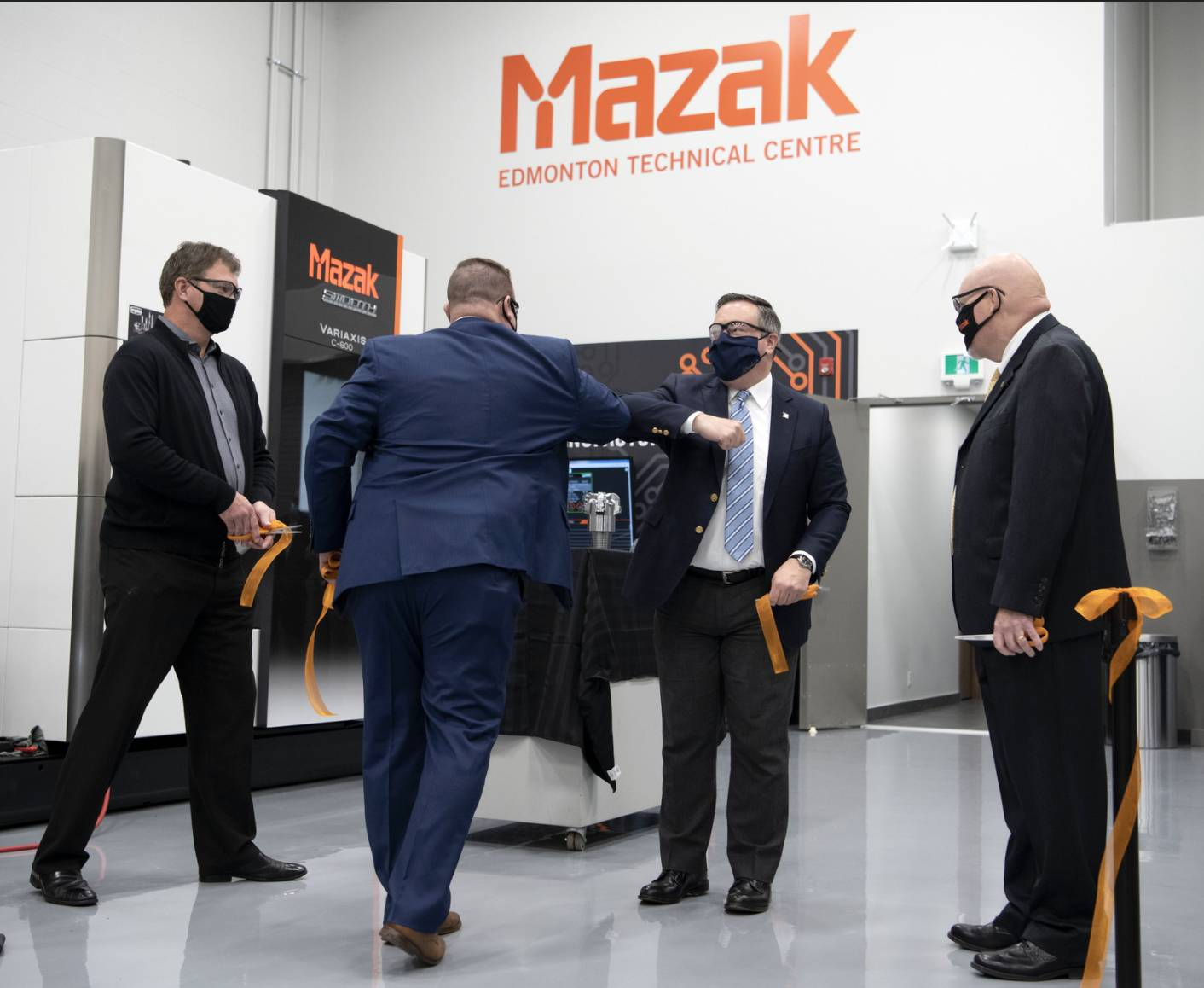 It was elbow-bumps all around as Alberta Premier Jason Kenney joined Ray Buxton at the grand opening of Mazak's Edmonton Technical Centre. PHOTO: Chris Schwarz/Government of Alberta