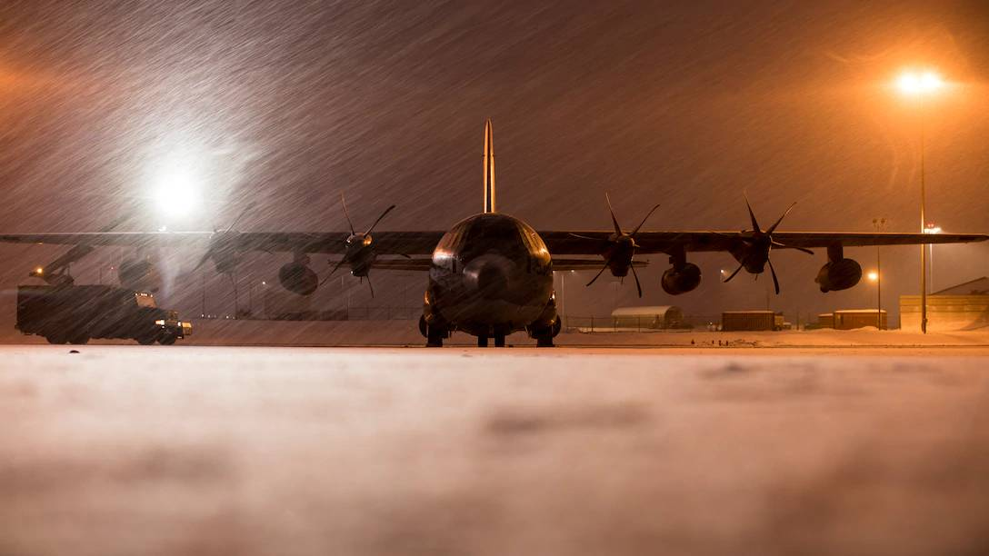 U.S. Marines de-ice a Marine KC-130J Super Hercules aircraft before takeoff from Joint Base Elmendorf-Richardson, Alaska, Dec. 9. PHOTO: U.S. Marine Corps photo by Cpl. Jackson Ricker/Released 201209-M-BH827-1075.JPG