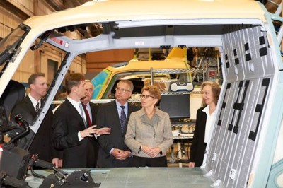 Ontario Premier Kathleen Wynne, Economic Development for Southern Ontario Minister Gary Goodyear and Airbus Helicopters Canada CEO Romain Trapp inspect a helicopter at the company's Fort Erie, ON, plant.