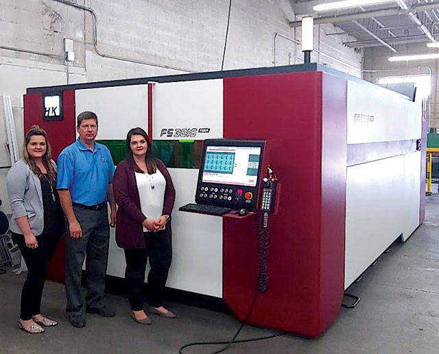 Amanda, Michael and Stephanie Grieger with the new fiber laser cutting machine.