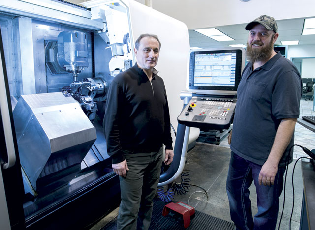 Elite Machining president Doru Gorzo, left, stands with machinist Geoff MacDougall in front of the DMG MORI CTX multi-tasking centre.