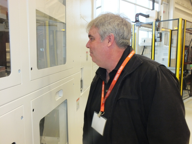 John O'Brien of Rice Tool & Manufacturing checks out automation on a Mazak machine