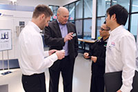 Matsuura's Thomas Houle discusses Lumex technology with his colleagues. Matsuura Machinery
