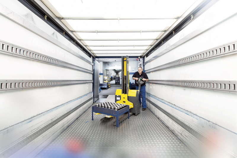 A Schunk worker loads the back of a semi-tractor with machined toolholders.