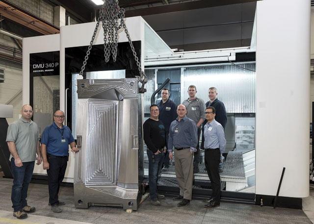 Bottom row left to right: Devin Rumley, Brent Hale, Kevin Krmpotich, Chris Edwards, and Nicholas Piccione.   Top row: Rob Lavereau, Chris Holsgrove and Tyler Rose. The part machined on the DMU 340P machine is half of a mould used to make aerospace interior parts.