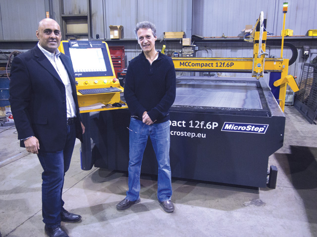 Kal Shergill, president of MicroStep Canada, with Tony Leal of ASE. Leal says the plasma machine has helped streamline processes.