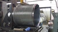 Machining a large screen basket for a paper mill.