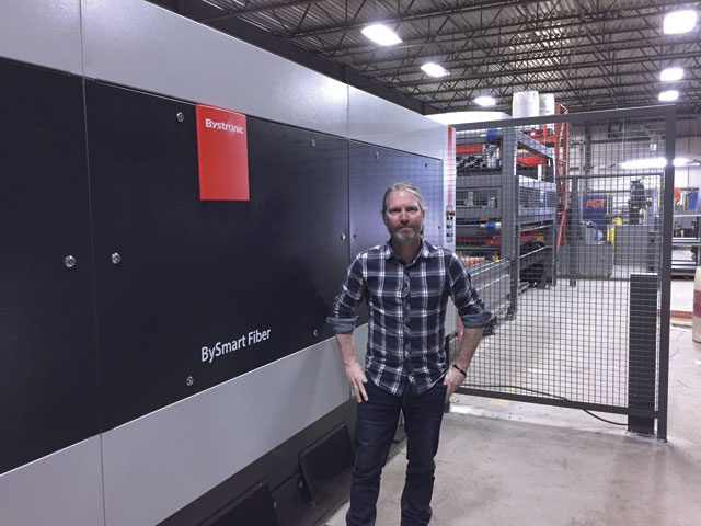 Sylvain Piché, EPP Metal's technical manager, with the BySmart fiber laser. The company selected Bystronic because it liked the technology and the price point.