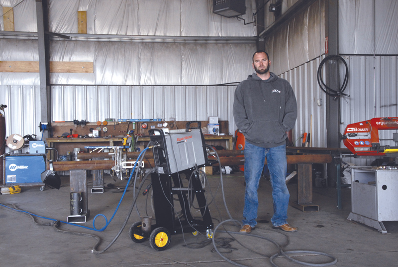 Bryce Bernhard, seen here, purchased a versatile Hypertherm plasma cutter to help him meet customer needs. Image: Nestor Gula