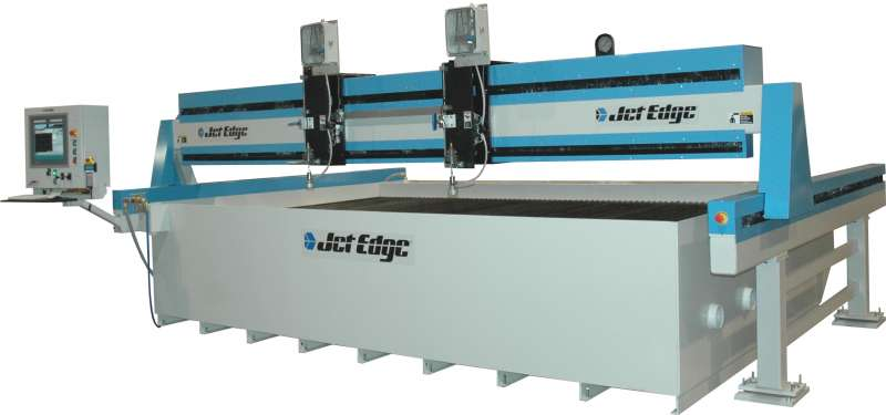 Jet Edge mid rail gantry waterjet system runs up to 4 cutting heads