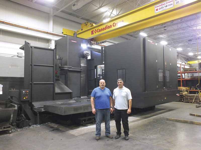 The Doosan 130L II, seen here, is the largest and most recent of four Doosan boring mills in Rova Machine's shop. Vince Mainella, seen at left beside partner Andy Lombardi, says the Doosans are stronger and more accurate than some of his other machines.