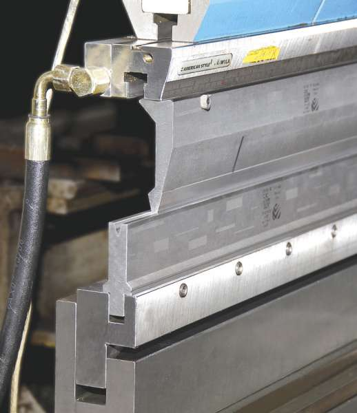 Wila hydraulic hemming table with manual die clamping in a LVD press brake with American Style acute angle tooling.
