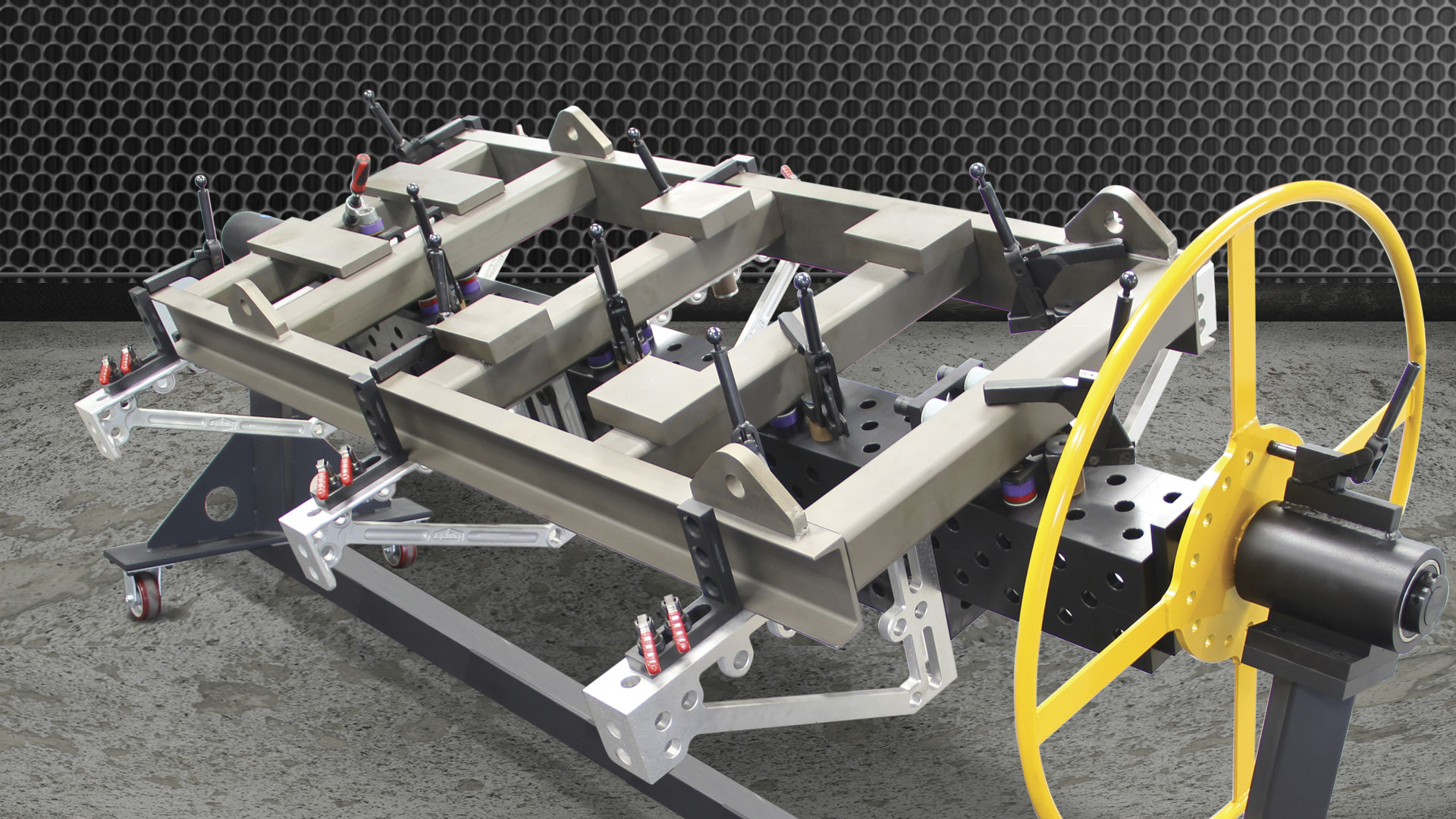 A rollover rotating positioner with a heavy duty modular spine for heavier parts with a load capacity of 1,360 kg (3,000 lb).