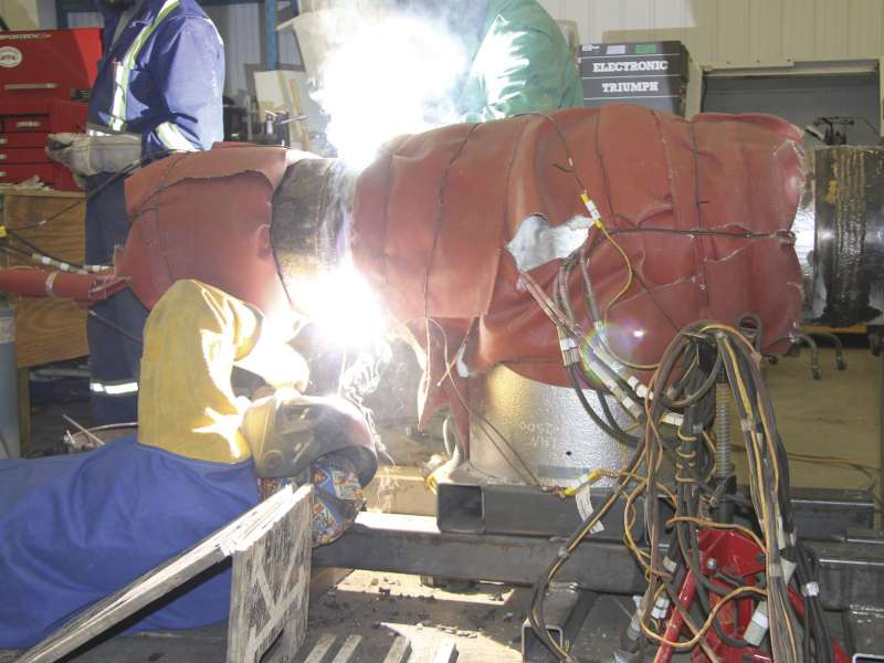 "A worker at PMT""s facility welds pieces together on a valve."