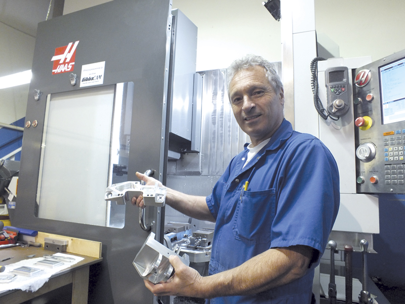 Leon Massa shows a part machined on the Haas five axis machine in his shop.