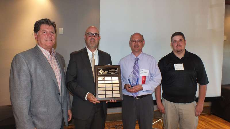From left: Norm Marcoux, president of Advanced Machining Services; Robert Cattle, CTMA executive director, Igor Babamov, inaugural award winner, Advanced Machining Services; and Steve DePepentigny, apprentice and nominator, Advanced Machining Services