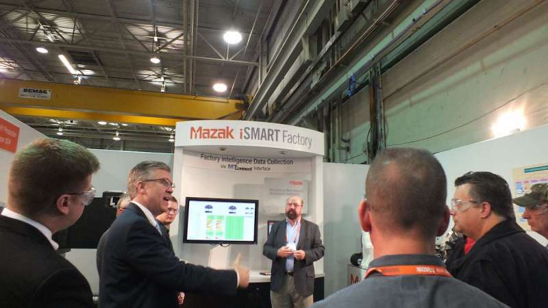 Explaining Mazak's iSMART Factory concept to visitors